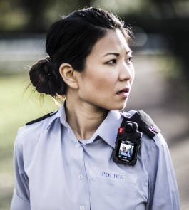 Policewoman at work wearing body camera with front facing screen